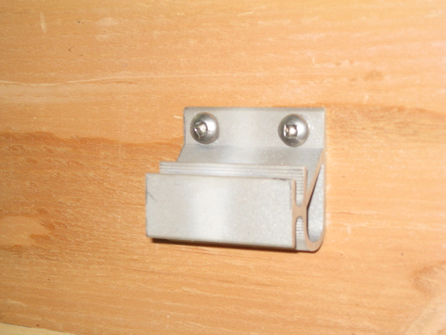 Climate Shield Clip screwed to plywood.