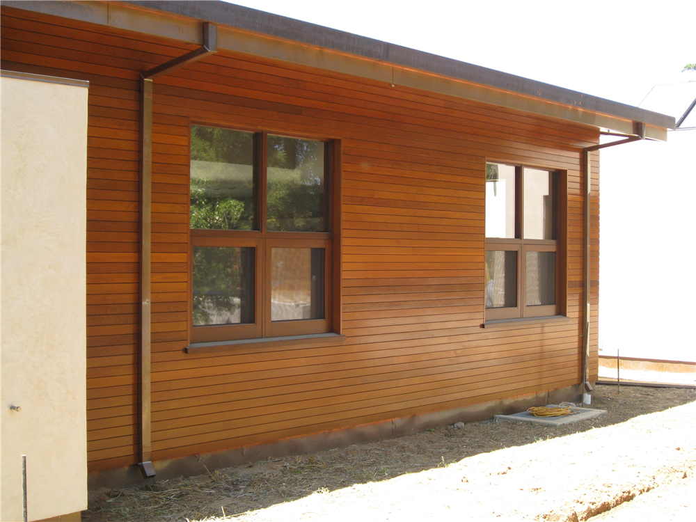 Rain screen clip application in Ipe tropical hardwood. San Francisco, CA, 2009.